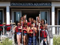 Truro rec department.  Local children paddle board with Provincetown Aquasports.